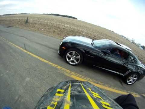 YZ450F vs 2010 Camaro SS - YouTube