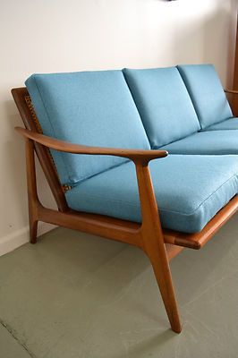 3 seater lounge made by Parker furniture in the 60's, freshly upholstered in a blue Kvadrat danish wool fabric (Divina Melange Aqua)   Lowline frame with rattan back, frame has been cleaned and oiled, minor wear from age. Inspection welcome  CONDITION - Great vintage condition, the frame has been cleaned and danish oil applied. Upholstery brand new.   DIMENSIONS - 163cm length, 86cm deep, 68cm tall