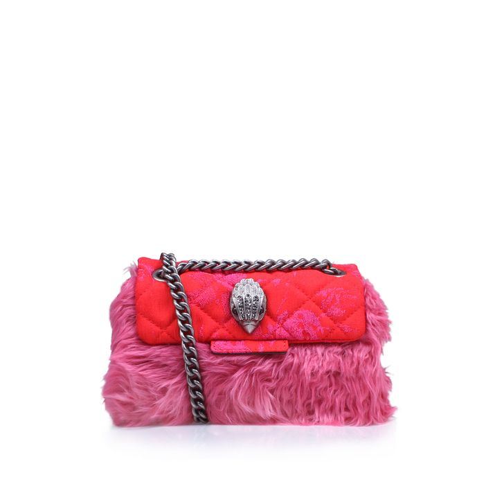 MINI KENSINGTON BAG  Pink Mini Bag.  Shake up your look with the kitsch new Mini Pink Kensington from Kurt Geiger London. Slung over your shoulder or across the body, this compact handbag in pink faux fur is trimmed with a detailed eagle embellishment for added fun. Bag Dimensions: 12cm H x 16cm W x 7cm D.