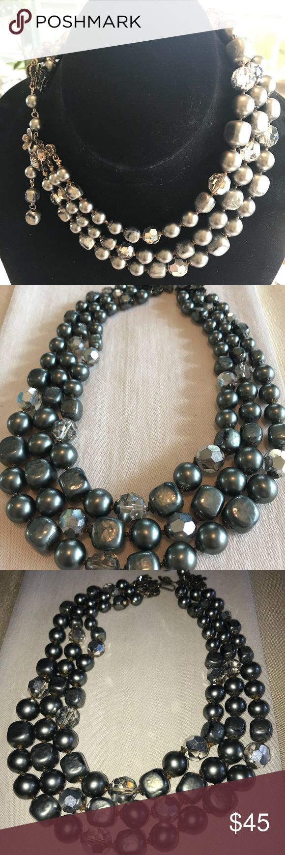 """Antique De Mario grey faux pearl necklace Rare jewelry maker here. The necklace is 17"""" total length. Three strands. Has a beautiful clasp and hook. Clear Faceted glass beads too. It has some tiny beads as spacers and a few have rusted and discolored the string and the little beads. Not too noticeable with the darker colors. De Mario Jewelry Necklaces"""