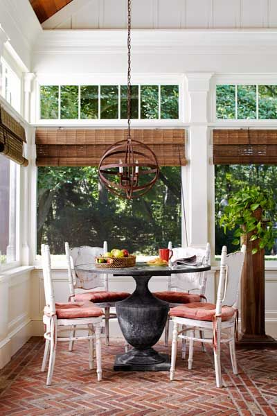 Layered trim and transom windows give this outdoor room its indoor ambiance. | Photo: Laura Moss