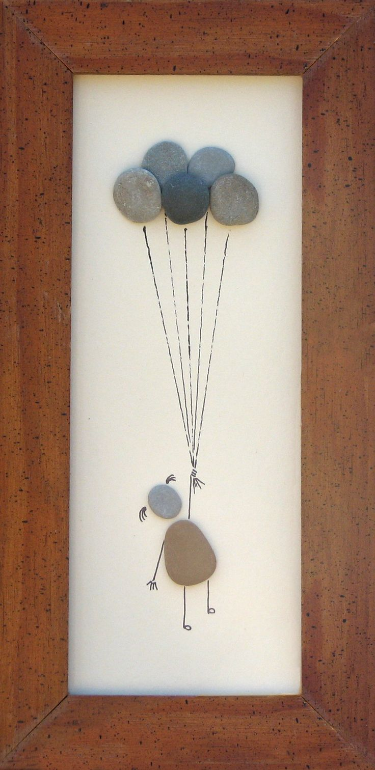 """""""Up, up and away"""" 12"""" x 4"""" Created using pebbled I collected on the shores of Lake Michigan."""
