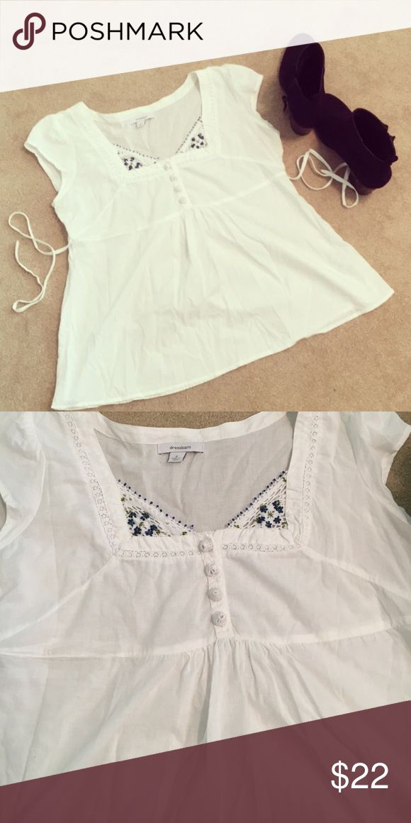 White short sleeve top Super adorable white short sleeve top with beaded flowers at the top. It's flowy at the bottom and also has two strings on each side that tie in the back. It has 4 buttons at the top. Size small but I would say it could also fit a size medium. It's in great condition! Offers are welcome :)  Tops