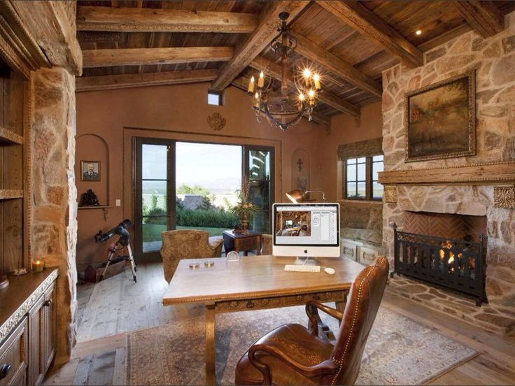 bathroomsurprising home office desk. the old world explorers would feel right at home in this rustic office with its vaulted exposedbeam ceiling wrought iron chandelier and enormous bathroomsurprising desk e