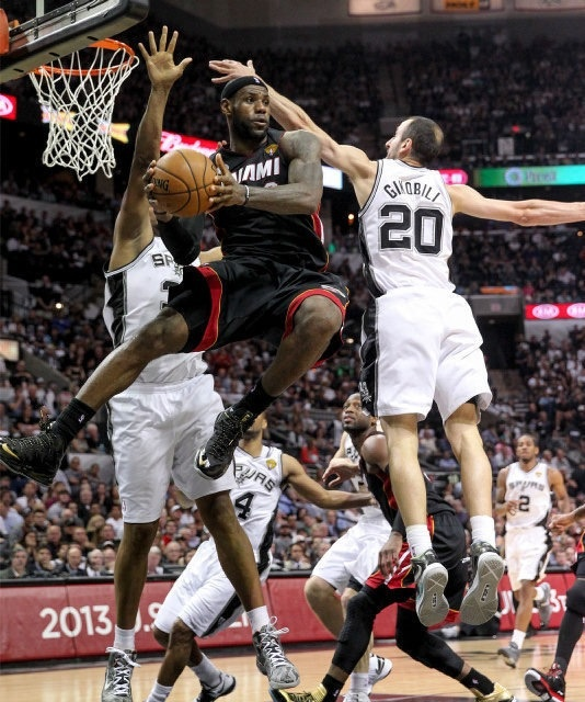 Great picture!  LeBron passes the ball under the basket during the fourth quarter of Game 4 of the NBA Finals vs the Spurs.  The Heat evened the series 2-2!!!