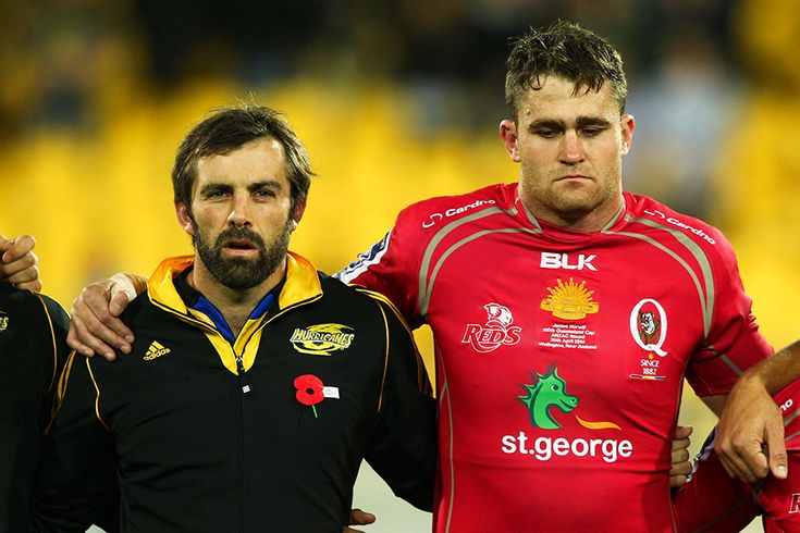 Conrad Smith of the Hurricanes and James Horwill of the Reds share a moment's silence to mark Anzac Day