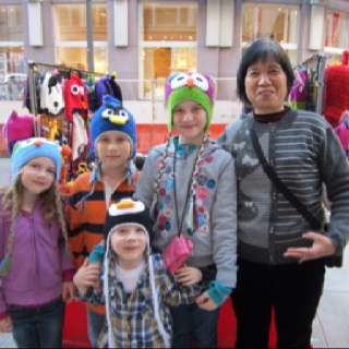 Awesome knitted hats, modelled by my children, aka The Gang of Four, from a stall in San Francisco.  The lady in the picture made the hats.  I don't know her name.  There were a few other stalls around SF but we liked hers best - and got them for a good price too!  Louise Sutton, Jan 2012