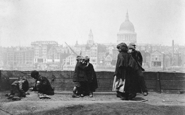 Children playing on the Southwark bank of the Thames in the 19th century, a part of London which was notorious for its squalid living conditions.