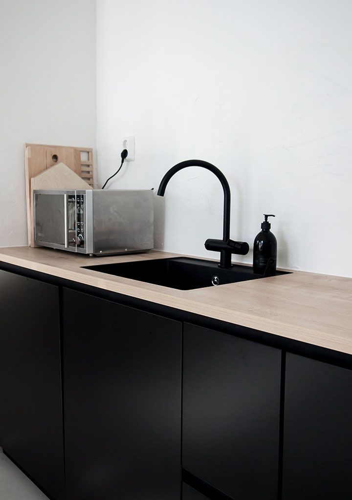 black cabinets, blonde wood top.