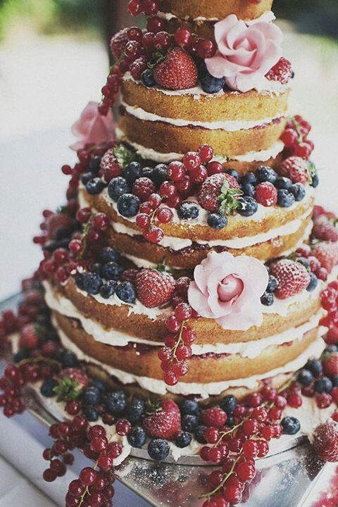 "Rustic, ""naked"" wedding cake. Love all of the fruit instead of tons of sugary icing!"