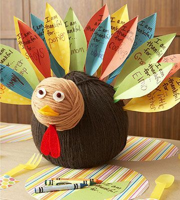 What a Turkey - Ask each child to write what she's thankful for on a paper feather, then stick it into this cute turkey centerpiece. #thanksgiving #kidfriendly #crafts #project