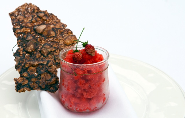 English strawberry granita with arabesque wafer.    Greg Malouf's sublime strawberry granita recipe, made from English strawberries, is served with a crunchy wafer in this quintessentially British recipe. Serve this on a lazy summers day.