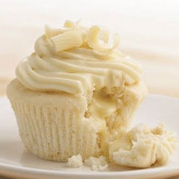 Heavenly White Chocolate Cupcakes found @ http://juliescafebakery.com Please repin and share it as its such a delicious #cupcake #recipe  1¾     cups of good quality cake flour 2     tsp of  baking powder 2/3    cup of fresh  whole milk ½     tsp of Double-Strength Vanilla 4     medium sized egg whites, at room temperature 6     tbsp of softened butter ½     cup of  granulated sugar ¼     cup of  sour cream 12     round white or very dark chocolate unwrapped truffles