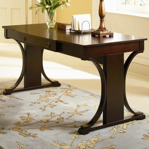 Perfect for penning to-do lists or organizing mail, this stately writing desk features a cherry finish and ring drawer pulls. Top it with a glowing lamp and antiqued vase for a space-saving living room display, or add it to the master suite to craft a stylish vanity.