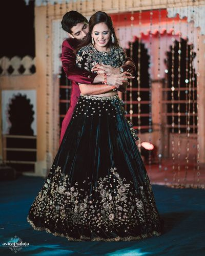 Candid Couple Shots - Bride in a Velvet Green Lehenga with Golden Embroidery and the Groom in a Marsala Sherwani | WedMeGood #wedmegood #indianbride #indianwedding #lehenga #velvet #candidcoupleshot #couple Outfit by: Dolly J