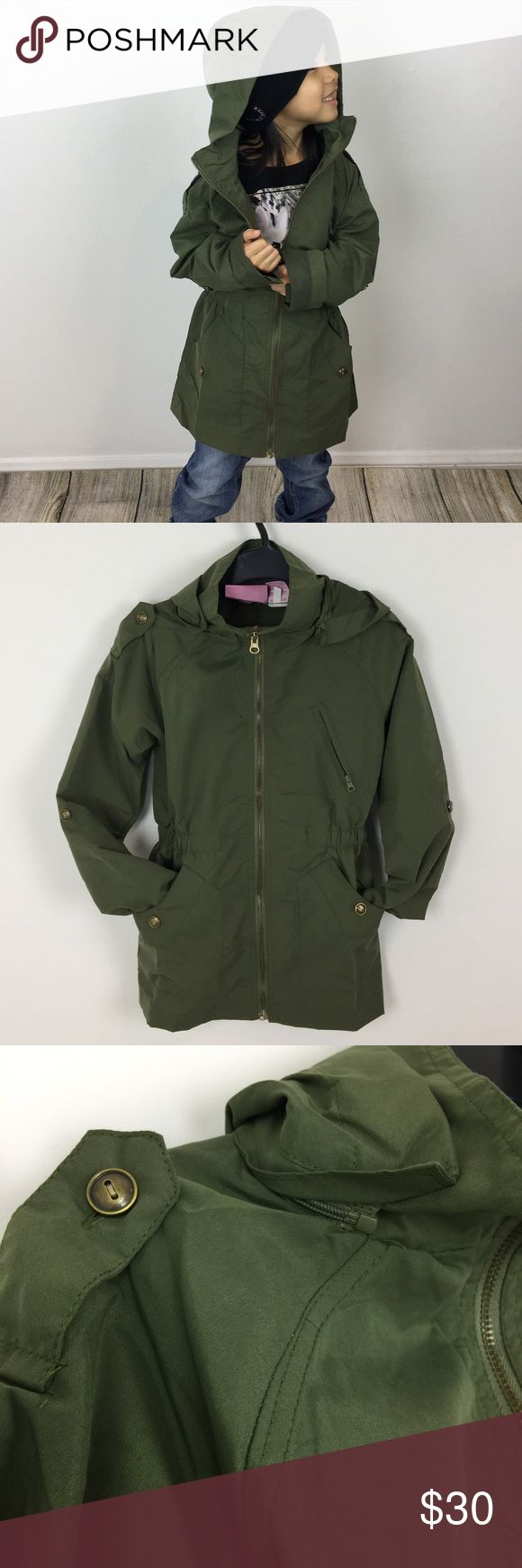 Little Girls Olive Green Military/Utility Jacket Perfect for your mini me! Kids olive green utility jacket is lightweight and features removable hood, 2 hand pockets, a chest zip pocket, shoulder straps, and an elastic waist. Sleeves can be rolled up and buttoned with sleeve tabs. Lead free, CPSIA Compliance. Sizes come in 4/5 and 6/6X. Jackets & Coats