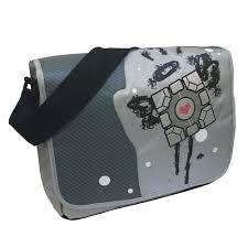 Your messenger bag from the popular Portal video game series by Valve is ready and waiting for you! The design features Aperture Science Laboratories' Companion Cube and the Portal 2 logo. Order the <strong>Portal 2 Original Companion Cube Messenger Bag</strong> for you or give it as a gift.