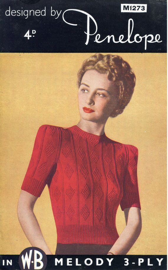 Wow! This is a lovely jumper with a great diamond pattern across the body and sleeves and the most amazing shoulders (I think that a pair of