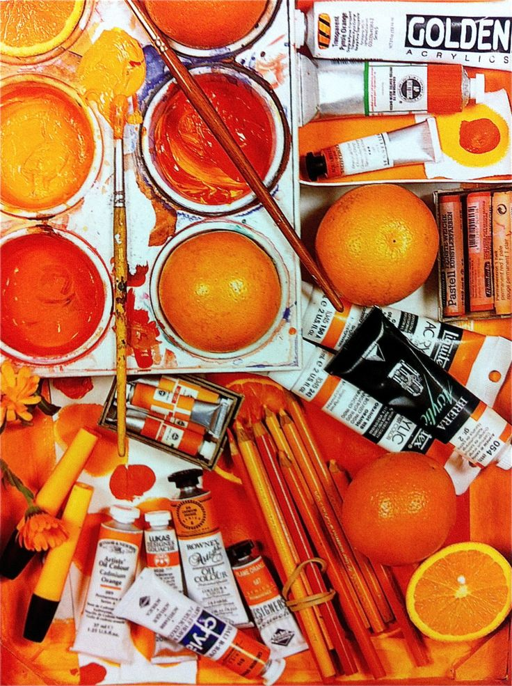 orange crayons and paints