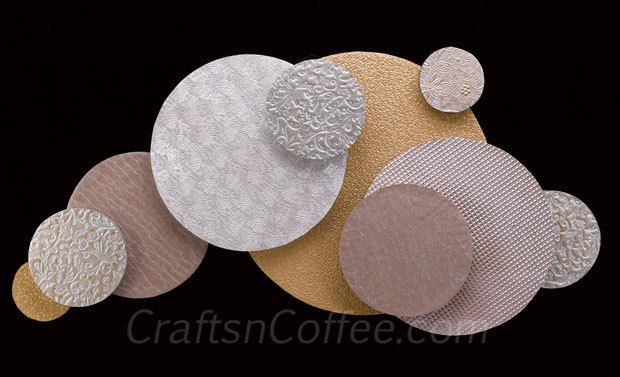 Very cool wall art! And it's not metal, it's paper and discs of Styrofoam brand foam. CraftsnCoffee.com.