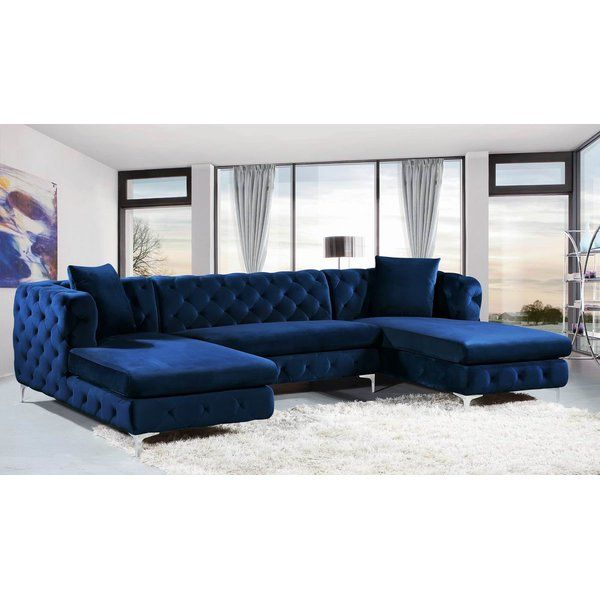 A Mod Take On Classic Chesterfield Sofas This U Shaped Sectional Goes Glam In Any Den Or Family Blue Couch Living Room Blue Living Room Decor Living Room Sofa