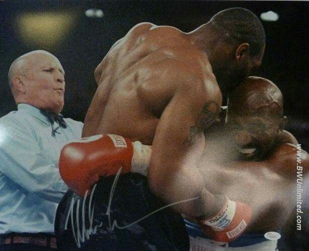 Charity Auction item - Mike Tyson autographed and framed 16x20 photo biting Evander Holyfield's ear www.BWUnlimited.com
