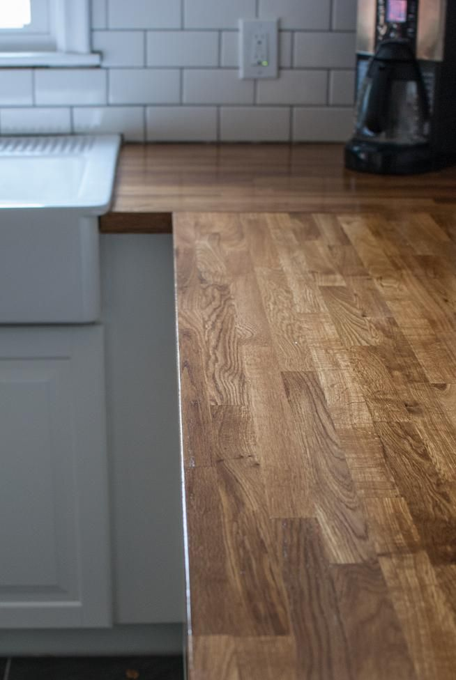... Wood countertops, White subway tiles and Butcher block counters
