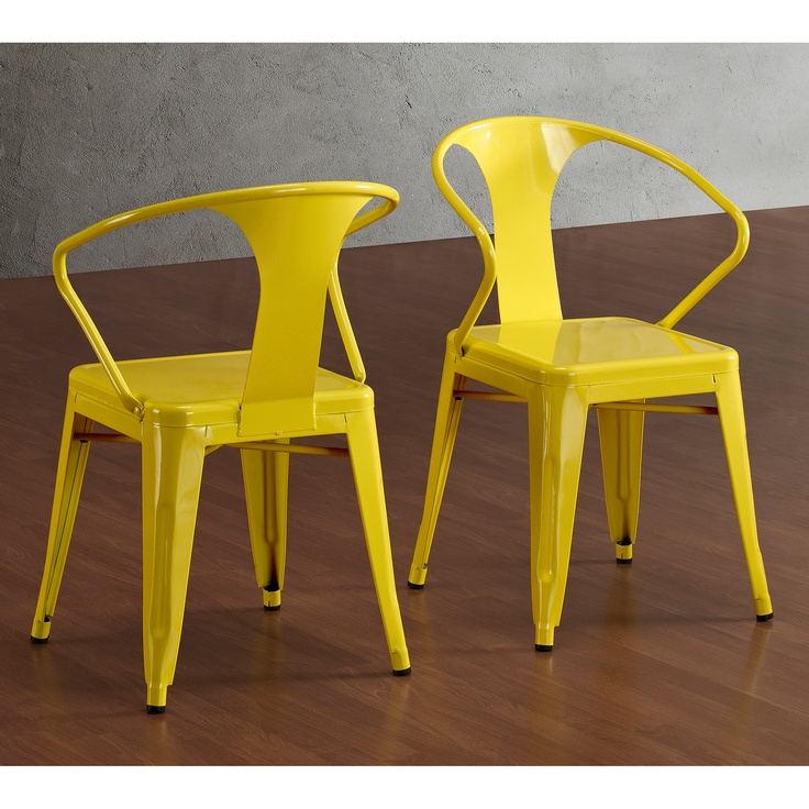 Modern yellow Metal stacking chairs for the wood claw foot table. Can stack and store the extra 4 when the leaf is out.