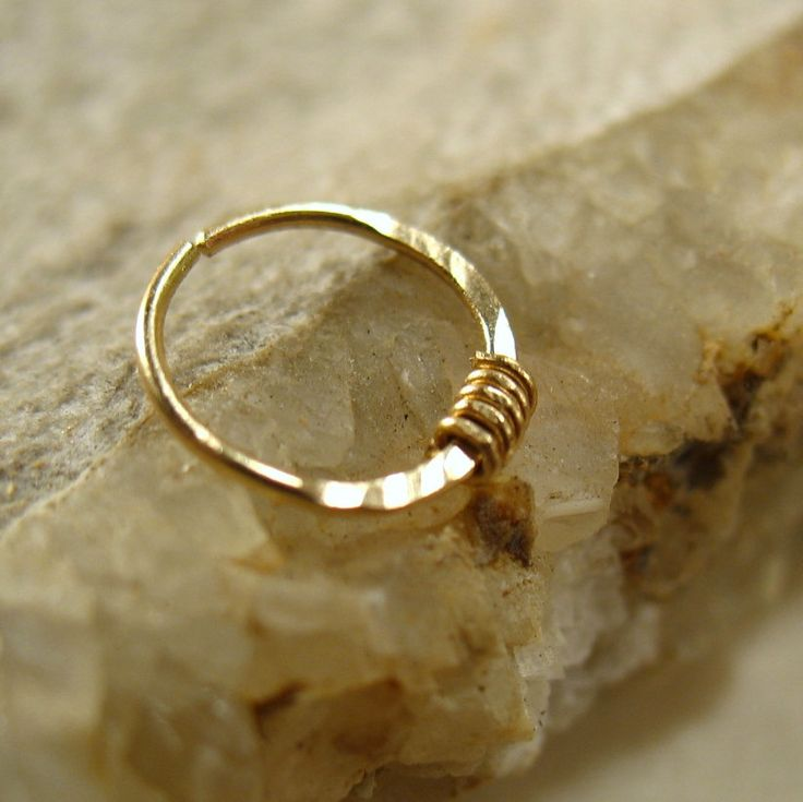 Nose Rings Solid 14k Gold with Solid 14k Gold Wrap 22 gauge Nose Jewelry Collection. $27.00, via Etsy.
