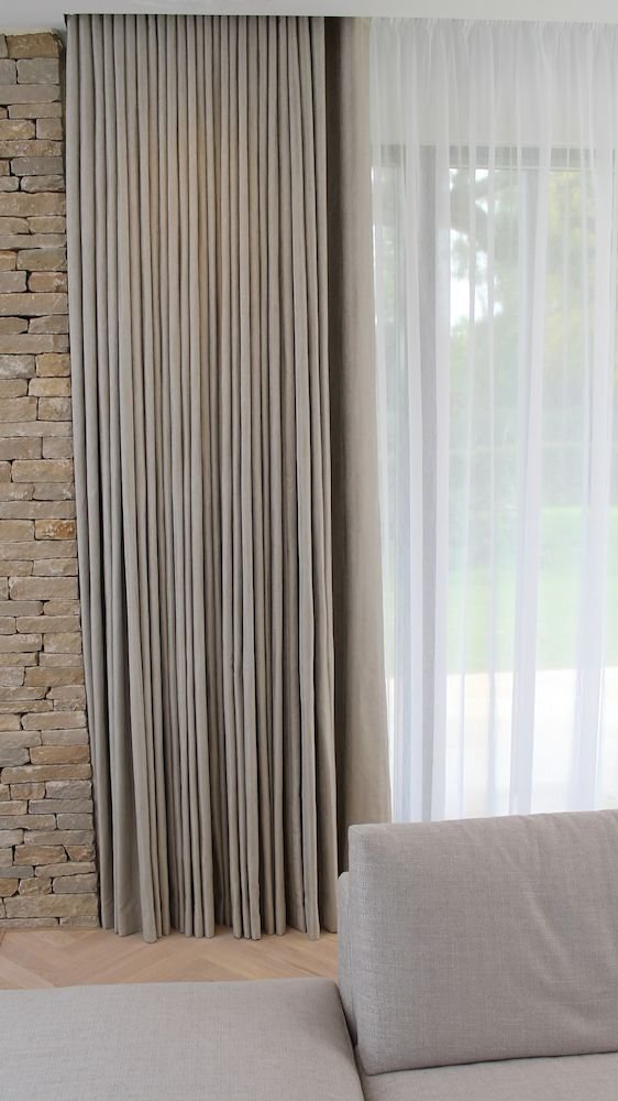 Wave curtains with pencil pleat headed voiles - window dressings by Beltaine Designs for the living room at a Marcus Homes development in Cheltenham.