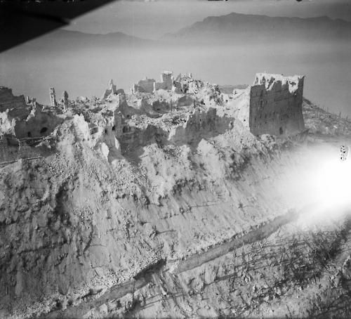 An aerial view of Monte Cassino showcasing the complete devastation reigned down onto the Monastery.