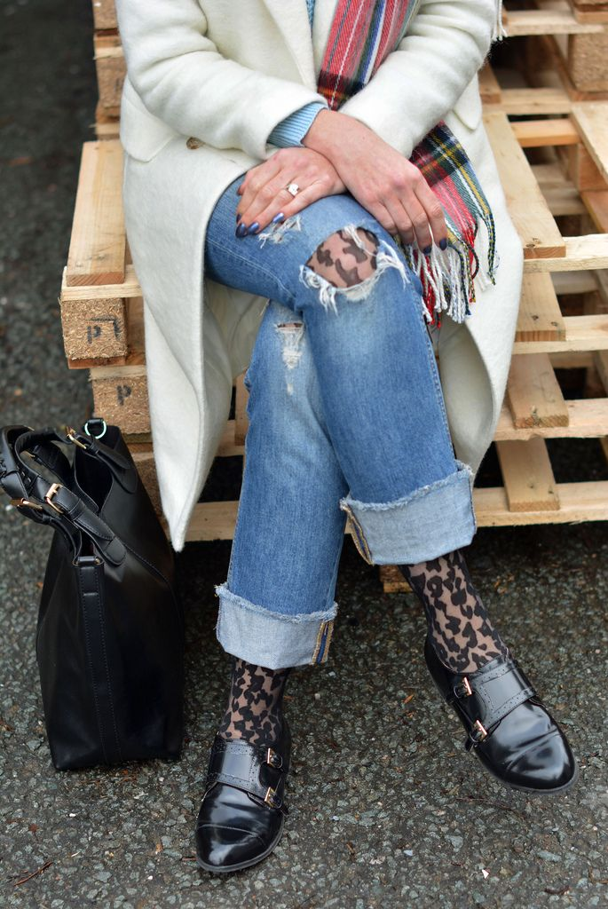Winter style: Long white coat, patterned tights under distressed jeans
