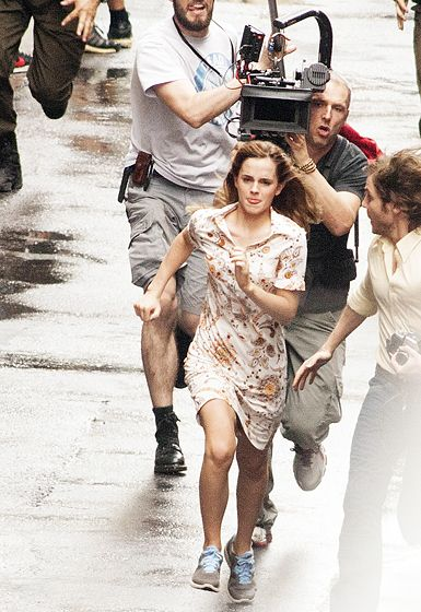 """Emma Watson made a run for it alongside costar Daniel Bruhl as they filmed scenes for the upcoming movie """"Colonia Dignidad"""" in Buenos Aires on Dec.8,2014"""