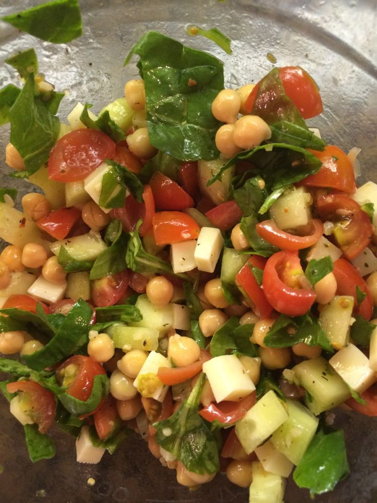Tomato and Chickpea Salad 1/4 C. cucumber, chopped 1/2 C. cherry or grape tomatoes, quartered 1/4 C. chopped spinach or other greens 2/3 C. Mozzarella cheese, cubed 3 Tbsp. extra virgin olive oil 1…