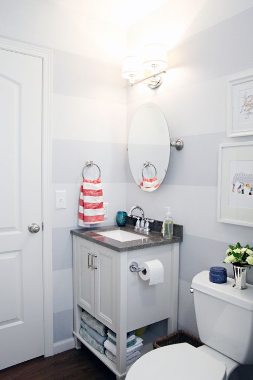 Love the stripes in the bathroom with the white cabinets.  Behr's Burnished Metal, Glidden's Misty Moonstone