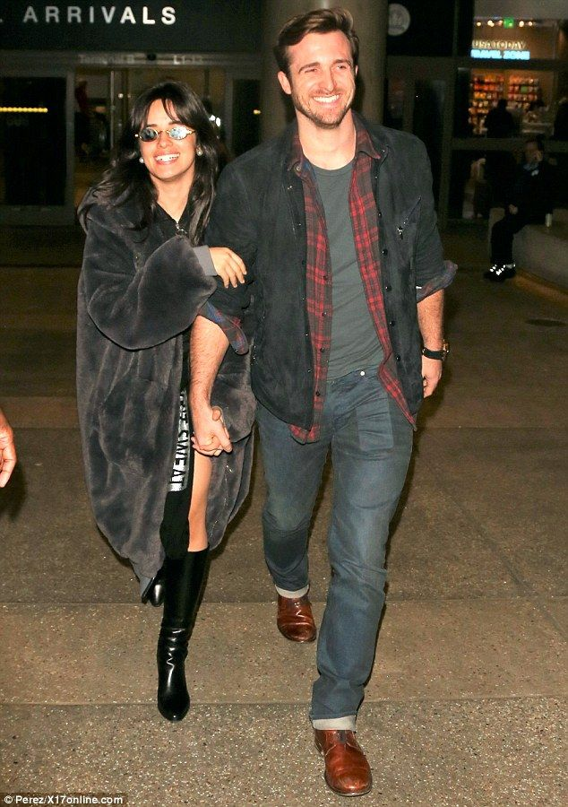 The look of love! Camila Cabello and British dating coach Matthew Hussey looked happy-as-can-be while jetting out of LAX for a romantic vacation Monday
