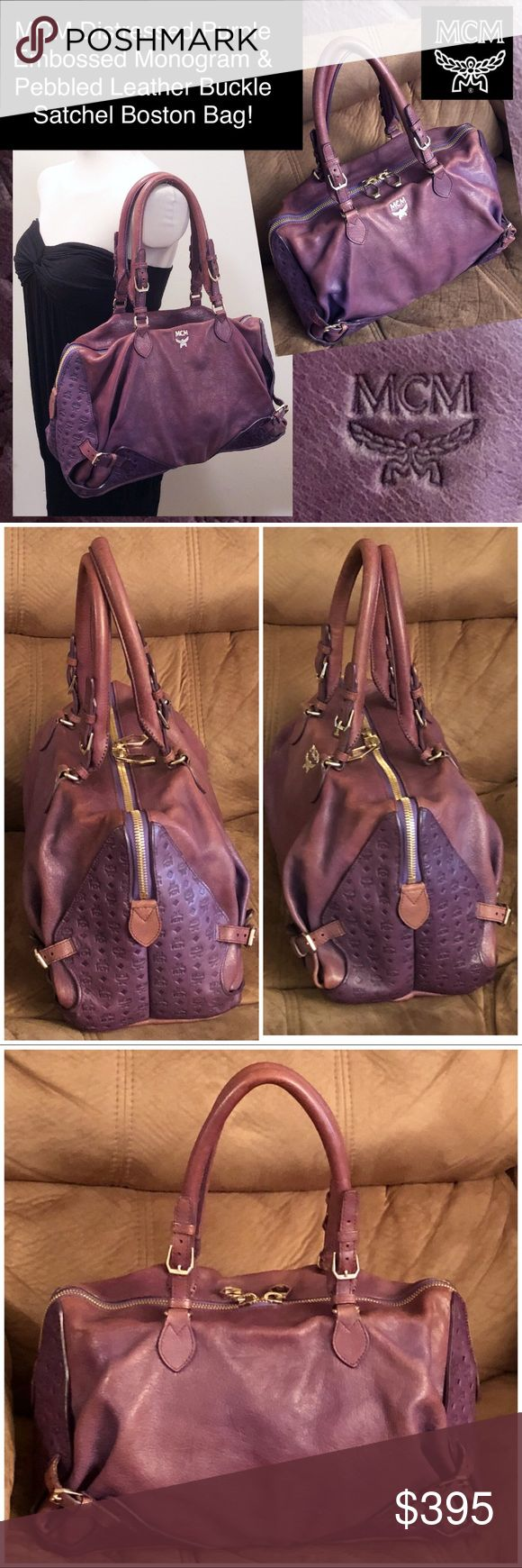 """MCM Embossed Monogram Leather Buckle Boston Bag! MCM Purple Embossed Monogram & Pebbled Leather Buckle Boston Satchel Bag! 100% authentic, """"MCM"""" embossed leather monogram & pebbled leather 2-tone purple design, rolled/adj (up to 12"""") top handles, 2 top zip closures, gold-tone MCM hw, suede like lining, 1 zip pocket, 1 snap pocket, 2 slip pockets, adj belted corners, MCM int stamp & white authenticity tag on int pocket, bottom feet. Ret:$1,220. 14""""L x 8.5""""H x 6.5""""W. Some int pen marks…"""