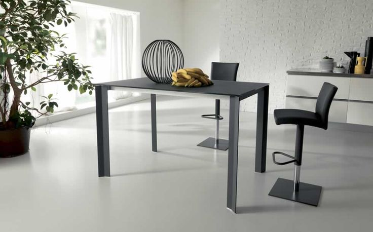 WING UP, design: Marco Pozzoli/Giacomo Mauri - Structural steel frame dining table with telescopic extending aluminium mechanism, inside extension, pyroceram, wooden, glass or plastic laminate top and extension. www.ozzio.com