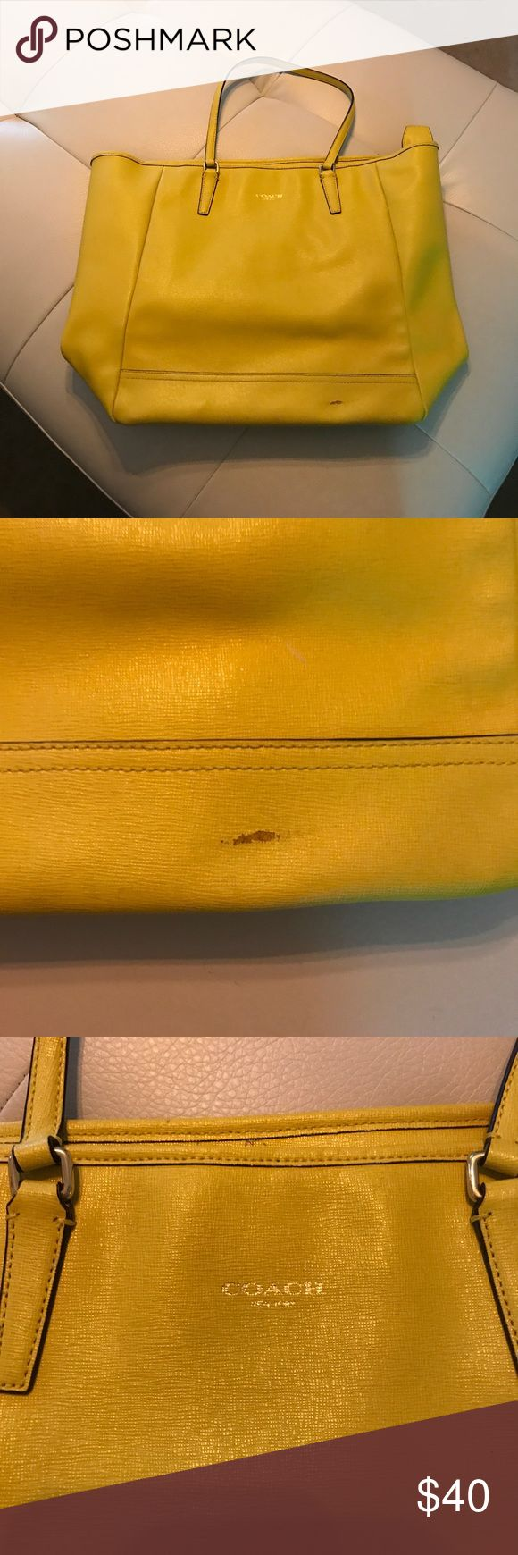 Yellow coach tote Well loved yellow bag. Flaw in front shown in picture. Lining also has lots of pen marks. Still a good bag though. Good for tailgating at hawkeye games Coach Bags Totes