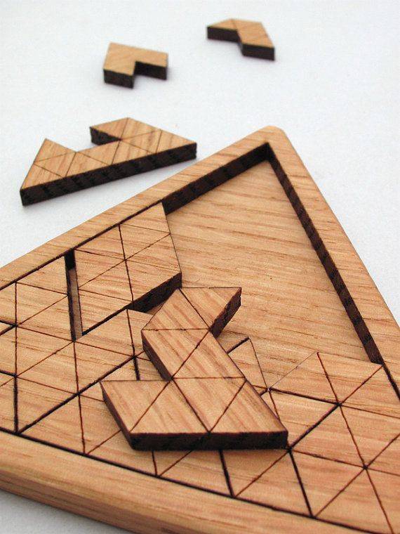 This laser cut triangles jig saw puzzle is made from sustainably harvested, solar-kiln dried, and locally grown Oak. This moderate difficulty