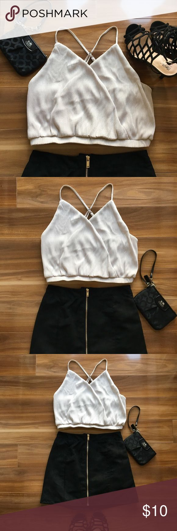 Sexy silver crop top 🥂 Perfect for date night or a girl's night out 🍾 Sexy silver crop top with straps can be paired with anything!   🌟Adjustable straps 🌟95% polyester, 5% spandex 🌟Large 🌟Hand wash recommended  🌺Make an offer 💰Bundle and save Tops Crop Tops