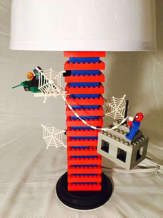 This is a handmade, Spiderman Lego Lamp. Featured on this lamp is Spiderman on a building in a battle against the villain The Green Goblin. The wooden bottom/stand has a layer of felt underneath to ensure no scratches upon tabletops. Lamp shade is included at an additional cost.  The lamp height with the shade is about 19.5     ~~~~~~~~~~~~~~~~~~~~~Save on Shipping!~~~~~~~~~~~~~~~~~~~~~ Buy any additional lamp at a discounted shipping rate!     ~~~~~~~~~~~~~~~~~~~~~~~~Lego…