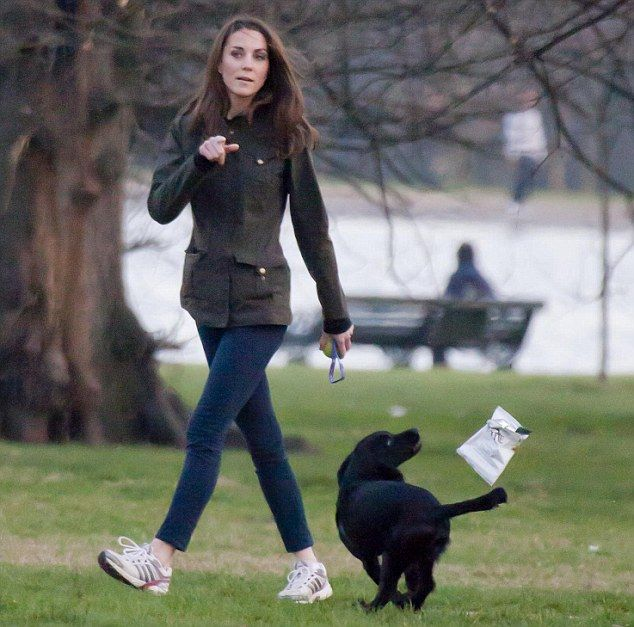 """No, Lupo! I said walkies, not Walkers! Duchess's dog snapped in hot pursuit of a crisp packet, nodoubt BBQ flavour. Looks like the Duchess of Cambridge still has some work to do on the """"Whistle"""" training, no not for William, Lupo the Cocker Spaniel."""