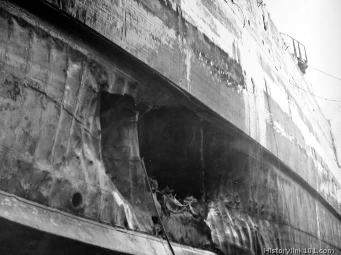 The USS California after the Japanese attack on Pearl Harbor, Dec. 7, 1941. In drydock, showing amidships torpedo damage.