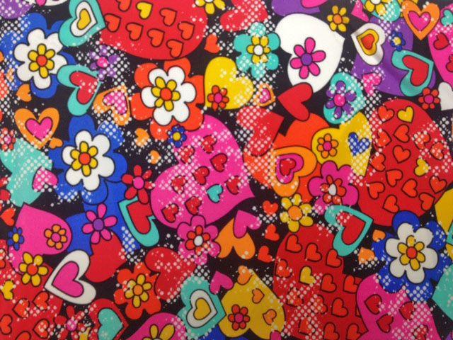 Graffiti Heart tricot spandex print   Pine Crest Fabrics   4 way stretch fabric available at Pine Crest Fabrics