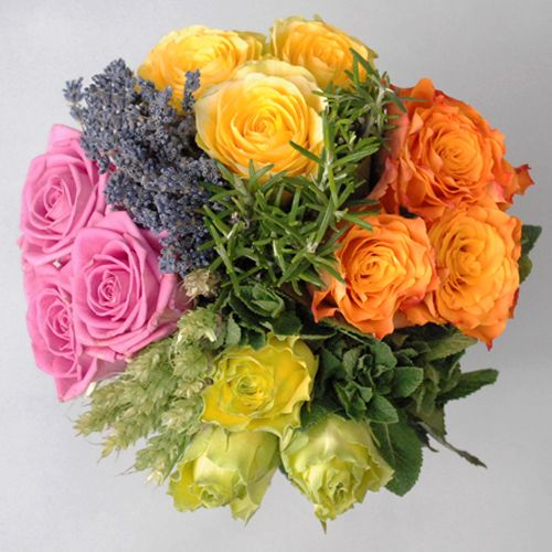 The Olympic Victory bouquet consists of four different types of roses sectioned into quadrants to mirror the 2012 logo. The roses being used are Illios (yellow), Marie Claire (orange), Wimbledon (green) and Aqua (pink).    The quadrants are then separated by English lavender, rosemary, apple mint and wheat which also provide a lovely fragrance.