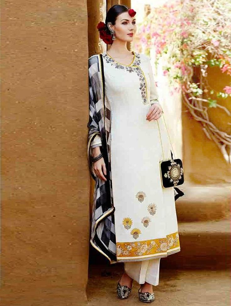 Give in to the exotic confluence of today and tomorrow in this classic white cotton and satin pant style salwar suit. This pant style salwar suit is embellish with embroidery work, lace border and resham embroidery. #designersuit #offwhitesuit #partywearsuit #bridalsuit #fancysuit #lookbuylike