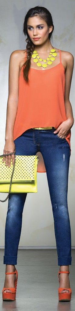 I love how she styled the Neon statement necklace with a neon clutch, then the high low blouse with the shoes