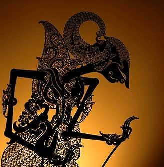 Wayang Kulit, is a type of puppet shadow play performed around the Indomalayan archipelago, tracing its origins to India. It is derived from a Javanese Hindu-Buddhist tradition, where hand-crafted leather puppets depict epic stories of the gods in shadow play. A traditional Gamelan orchestra would accompany the story-telling.