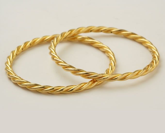 Twisted gold bangles